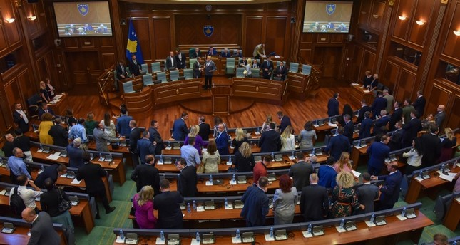 Kosovo's lawmakers leave the chamber after voting to disband the parliament during an extraordinary session in the capital Pristina, Thursday, Aug. 22, 2019 (AP Photo)
