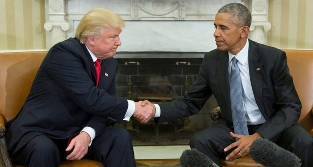 US President Barack Obama shakes hands with President-elect Donald Trump at the end of their meeting in the Oval Office of the White House in Washington.