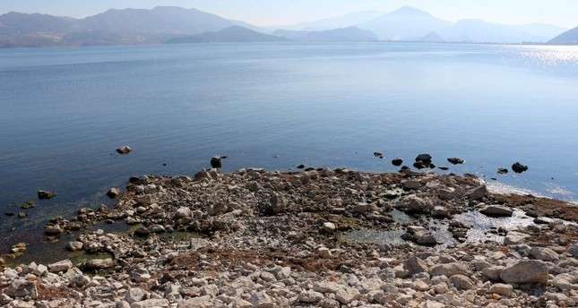 Lake Eğirdir water level and surface continues to shrink due to misuse and the effects of climate change. (DHA Photo)