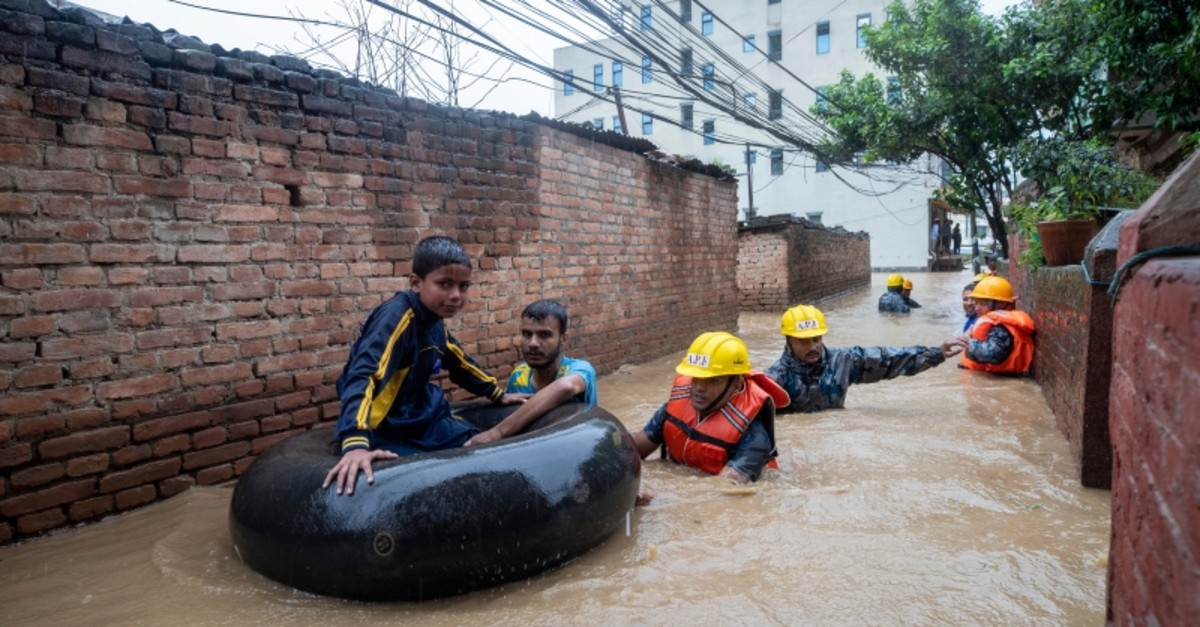 Members of armed police force rescue people from flooded houses following torrential rains in Kathmandu, Nepal, July 12, 2019. (EPA Photo)