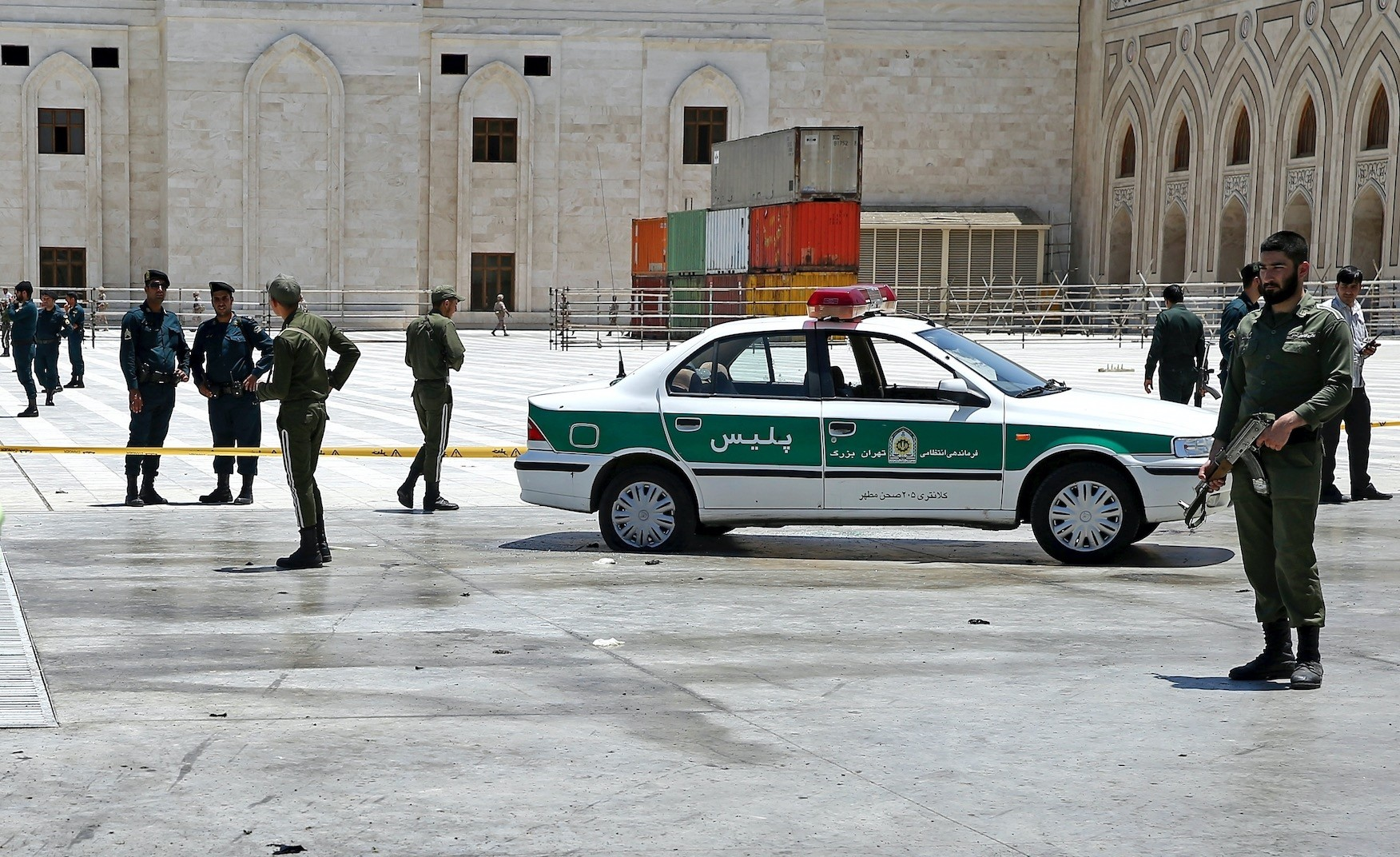 Iranian police officers control the scene, around the shrine of late Iranian revolutionary founder Ayatollah Khomeini, after an assault by several attackers in Tehran on Wednesday.