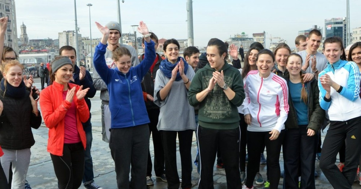 Erasmus students from 8 different countries having a work-out session in Taksim, Istanbul.