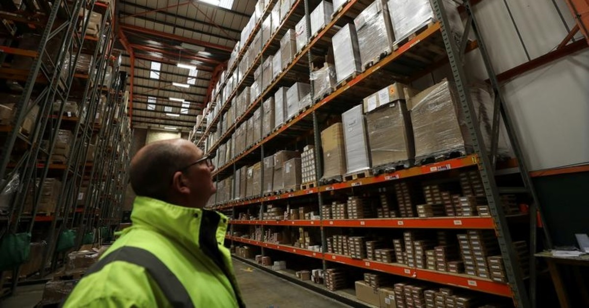 An employee looks up at goods at the Miniclipper Logistics warehouse in Leighton Buzzard, December 3, 2018. (Reuters Photo)
