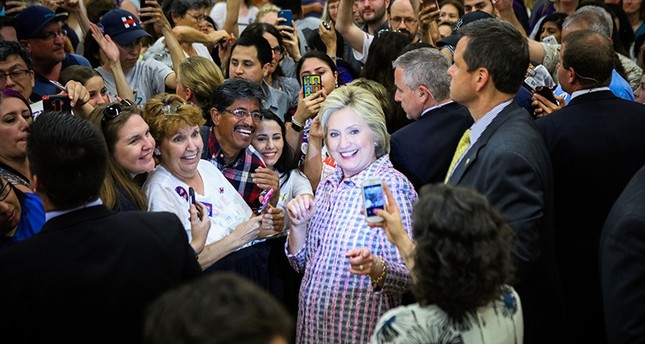 Democratic presidential candidate, former Secretary of State Hillary Clinton takes photographs with supporters after a campaign rally at Sacramento City College on June 5, 2016 in Sacramento, California. (AFP Photo)