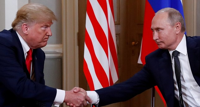 U.S. President Donald Trump and Russia's President Vladimir Putin shake hands as they meet in Helsinki, Finland July 16, 2018. (Reuters Photo)