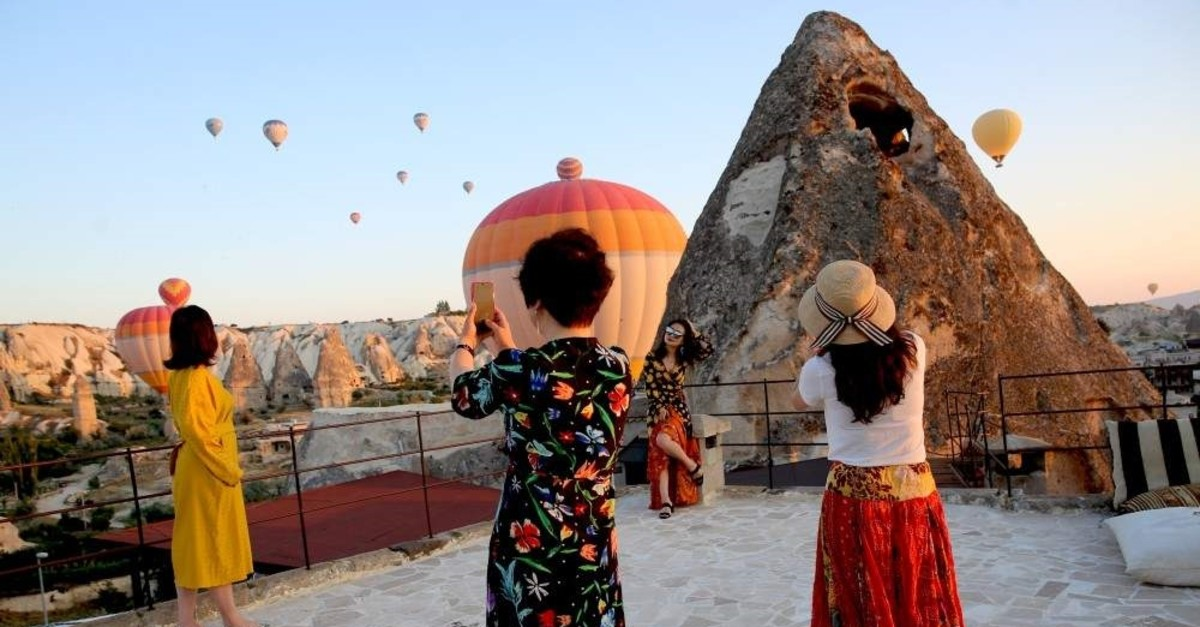 Tourists posing and taking photos in Cappadocia, one of Turkey's top tourist destinations. (AA Photo)