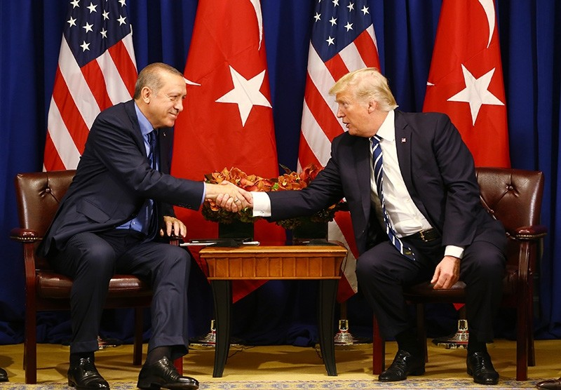Turkish President Recep Tayyip Erdou011fan shakes hands with U.S. President Donald Trump (AA Photo)