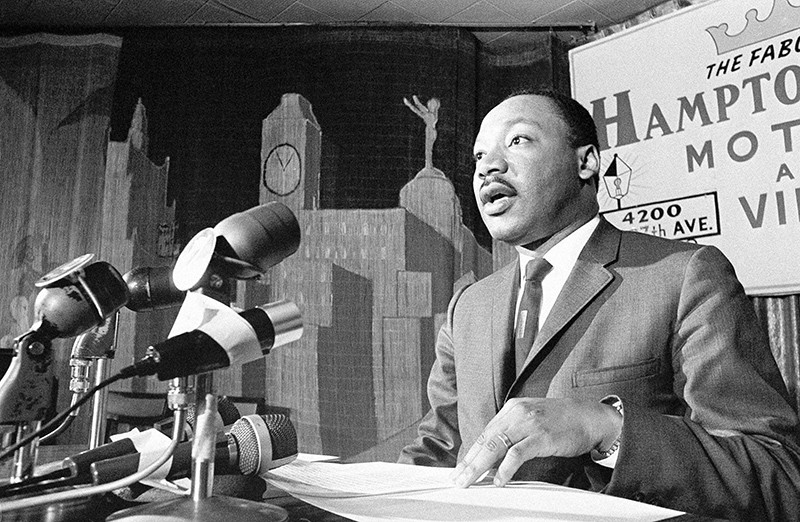 In this April 13, 1966 file photo taken by Toby Massey, Dr. Martin Luther King speaks during a press conference  in Miami on April 13, 1966 (AP File Photo)
