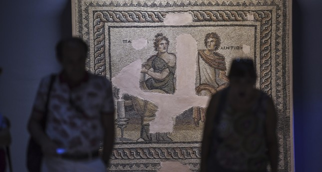 Visitors before a mosaic at the Zeugma Museum in Gaziantep.