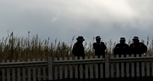 Local police stand guard in Durban, South Africa, Friday, June 11, 2010. (AP Photo)