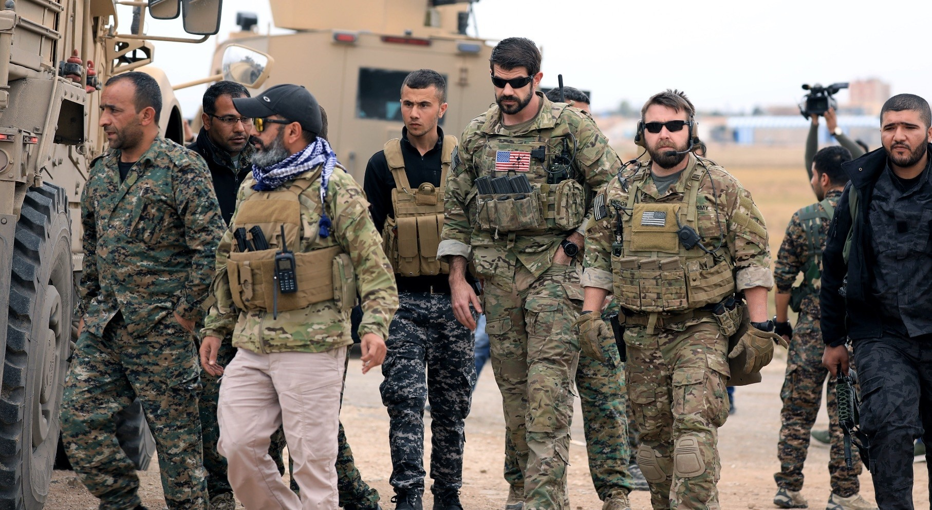 YPG militants and U.S. troops during a patrol near the Turkish border in Hasakah, Nov. 4.