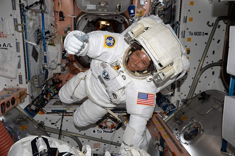 This NASA handout photo obtained May 12, 2017 shows Expedition 51 Flight Engineer Jack Fischer of NASA  seen inside the International Space Station (ISS) in his spacesuit during a fit check, in preparation for a spacewalk on May 12, 2017. (AFP Photo)