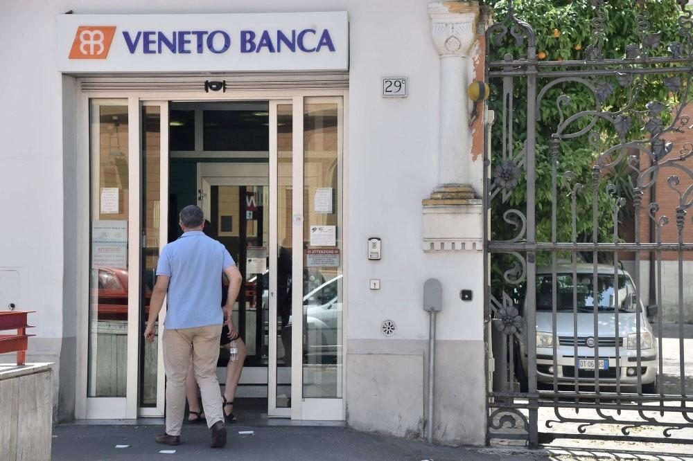 A man enters a branch of Italian bank Veneto Banca in Rome.