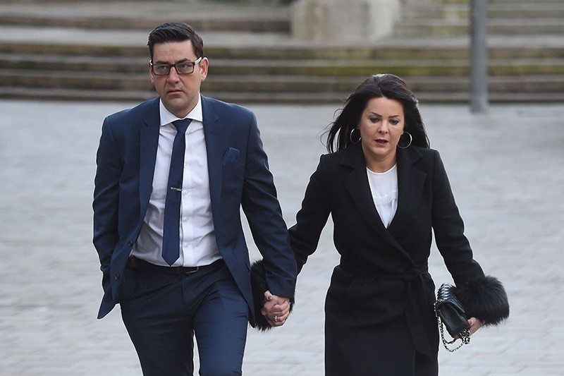 Former footballer and victim of abuse Andy Woodward (L) arrives at court with his partner Zelda in Liverpool on January 8, 2018 on the first day of the trial of former football coach Barry Bennell. (AFP Photo)