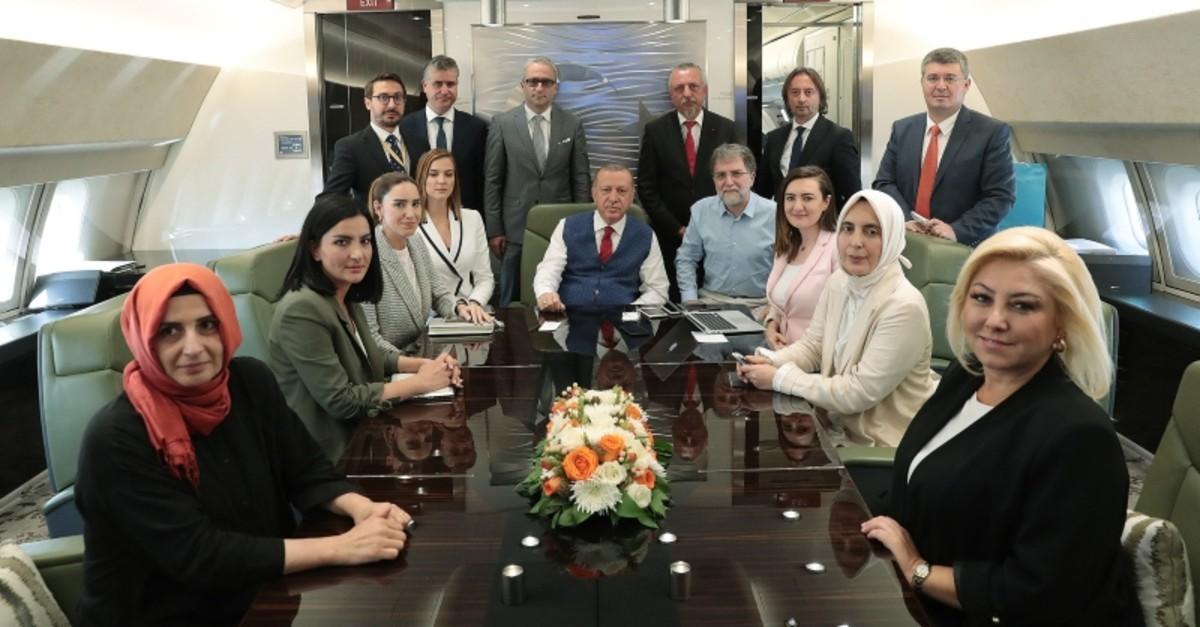 Erdou011fan with accompanying journalists