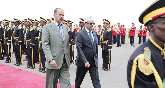Eritrea's President Isaias Afwerki (L) walks besides the Somalia's President Mohamed Abdullahi Mohamed during a welcoming ceremony upon his arrival for a three-day visit to Eritrea, in Asmara, Eritrea July 28, 2018. (Reuters Photo)