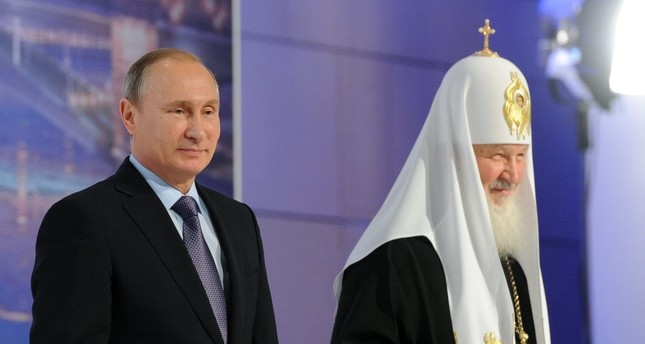 Russia President Vladimir Putin and Russian Orthodox Church Patriarch Krill (R), open the 5th International Congress of Compatriots, Moscow, Nov. 5, 2015.