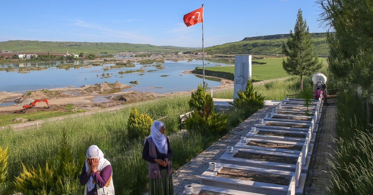 Women who lost their relatives in the PKK massacre visit their graves, May 11, 2019.