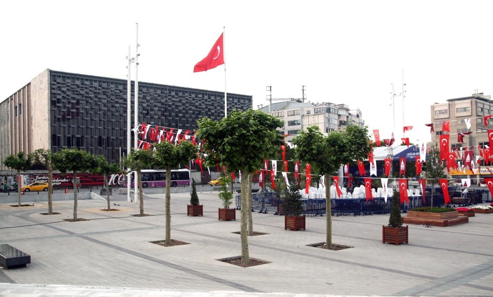 Workers planted plane, lime and olive trees in the square.
