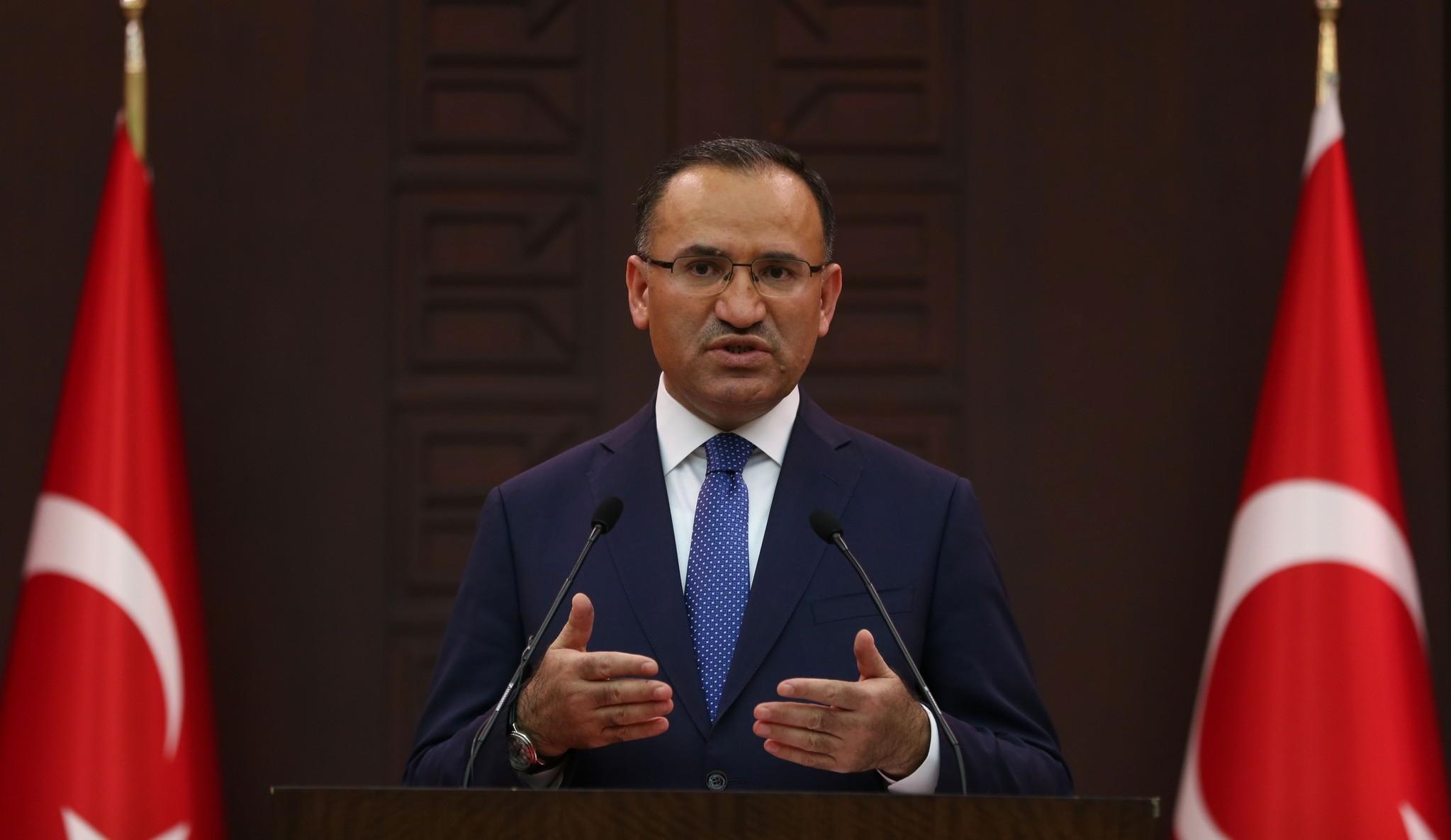 Deputy PM Bekir Bozdau011f speaks after a Cabinet meeting, in Ankara.
