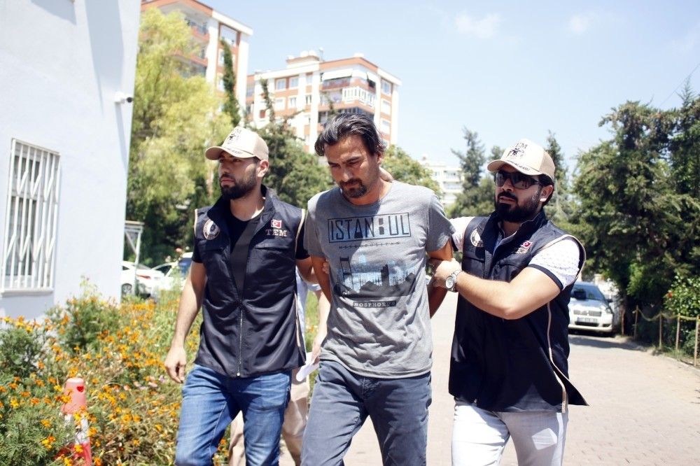 Anti-terrorism police escort Karacan following his capture.