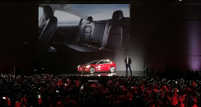 Tesla Chief Executive Elon Musk introduces one of the first Model 3 cars off the Fremont factory's production line during an event at the company's facilities in Fremont, California, U.S., July 28, 2017. (Reuters Photo)