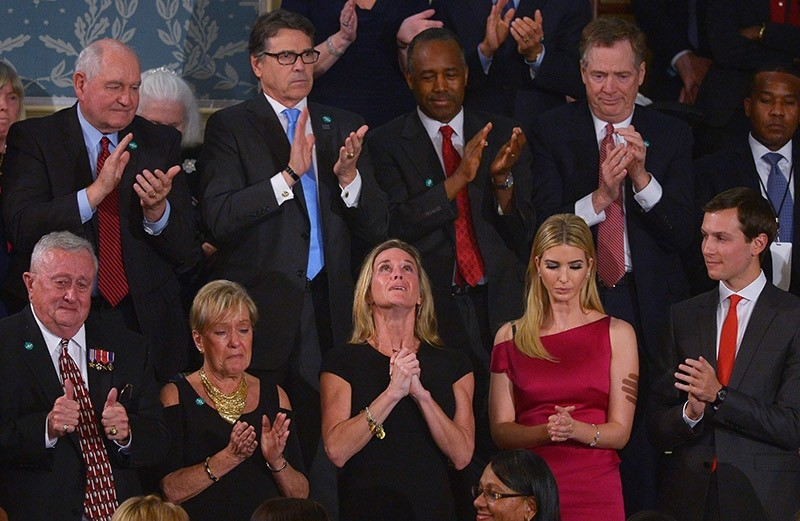 Carryn Owens, the wife of slain Navy SEAL William u2018Ryanu2019 Owens, looks up while being acknowledged by US President Donald Trump during his address to a joint session of Congress at the US Capitol in Washington, DC on Feb. 28, 2017. (AFP Photo)