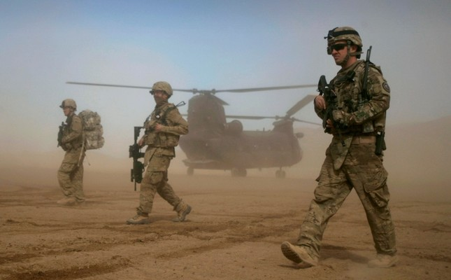 In this Saturday, Jan. 28, 2012 file photo, U.S. soldiers, part of the NATO- led International Security Assistance Force ISAF walk west of Kabul, Afghanistan. AP Photo