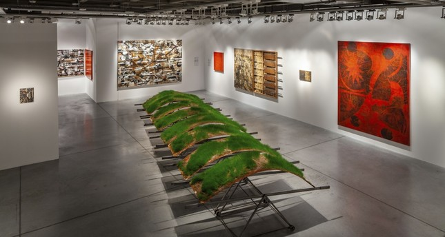 The artist's paintings, photos and installations in the exhibition make the audience rethink nature and the environment.