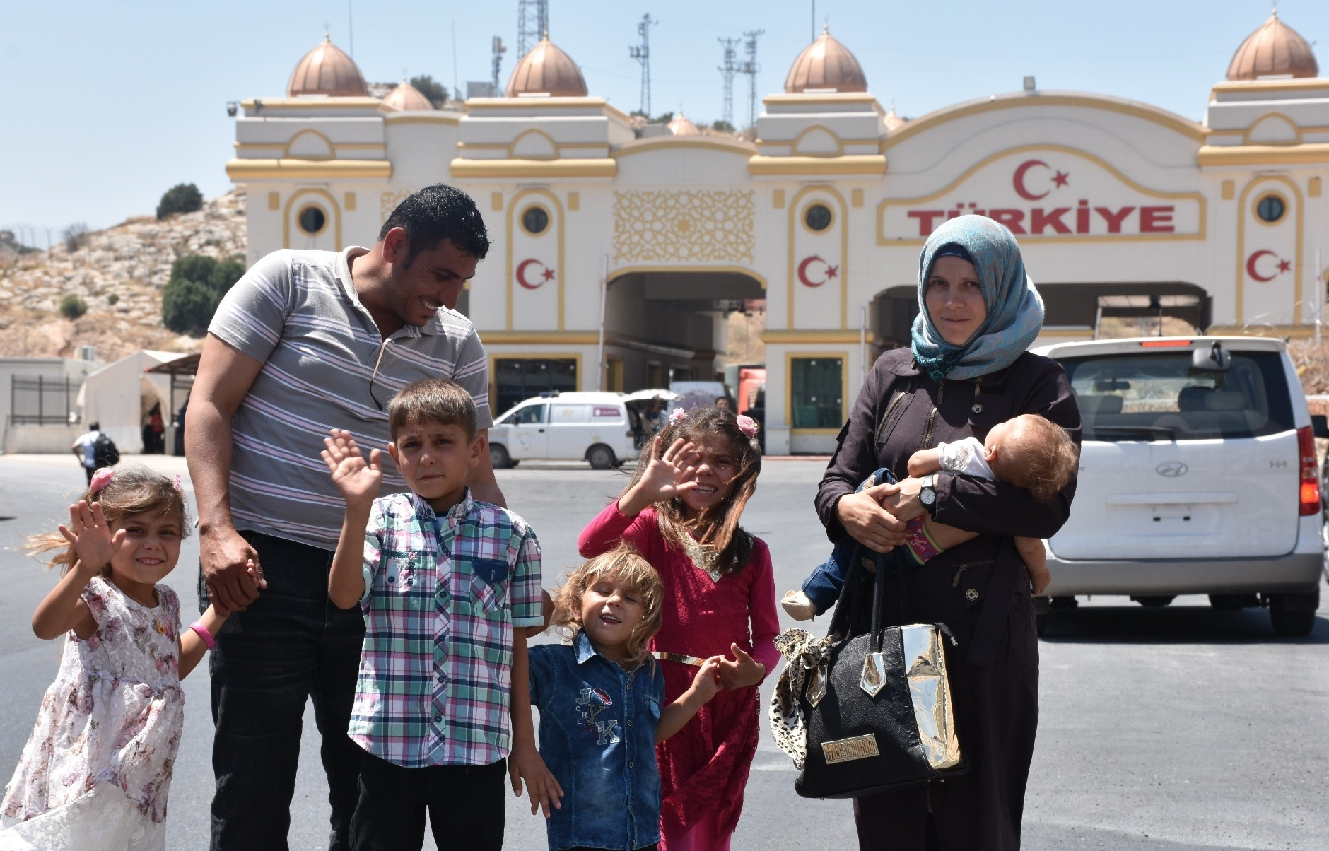Alena Nicoleta Pena, her husband and their children at a border crossing between Syria and Turkey.