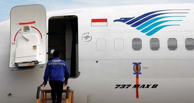 A technician prepares to check Garuda Indonesia's Boeing 737 Max 8 airplane parked at the Garuda Maintenance Facility AeroAsia, at Soekarno-Hatta International airport near Jakarta, Indonesia, March 13, 2019. Reuters Photo