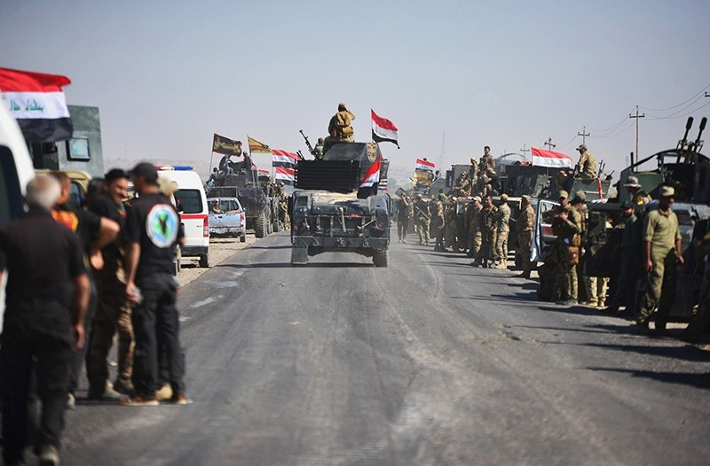 Members of Iraqi federal forces gather to continue to advance in military vehicles in Kirkuk, Iraq October 16, 2017 (Reuters Photo)