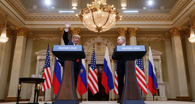 U.S. President Donald Trump waves after a joint news conference with Russian President Vladimir Putin (R), Helsinki, July 16, 2018.