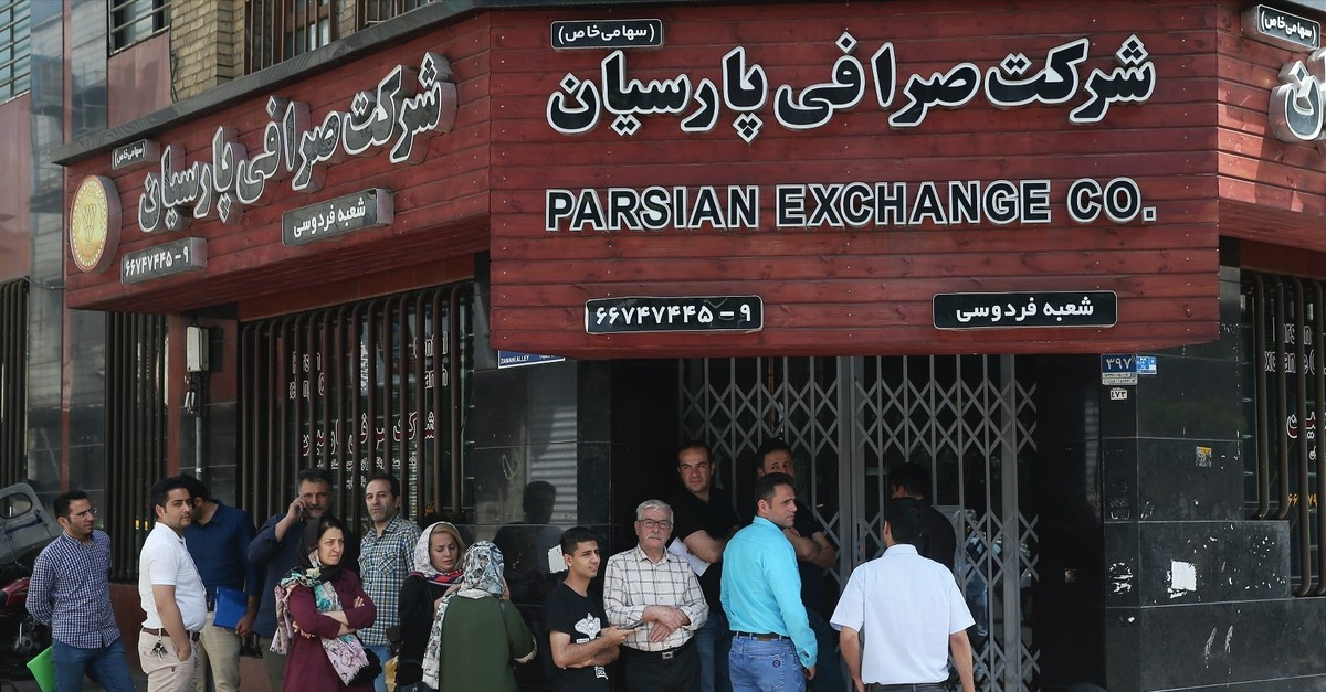 People line up in front of a currency exchange shop in downtown Tehran, May 8, 2019.
