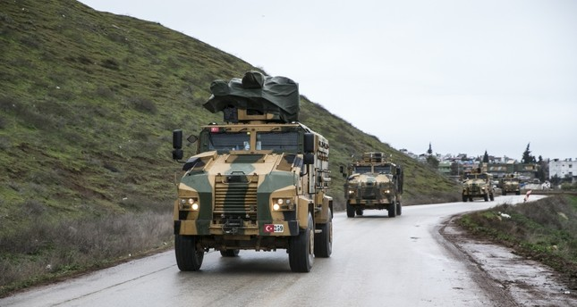 Turkish military vehicles carrying reinforcements head toward the observation posts in Idlib province AA Photo