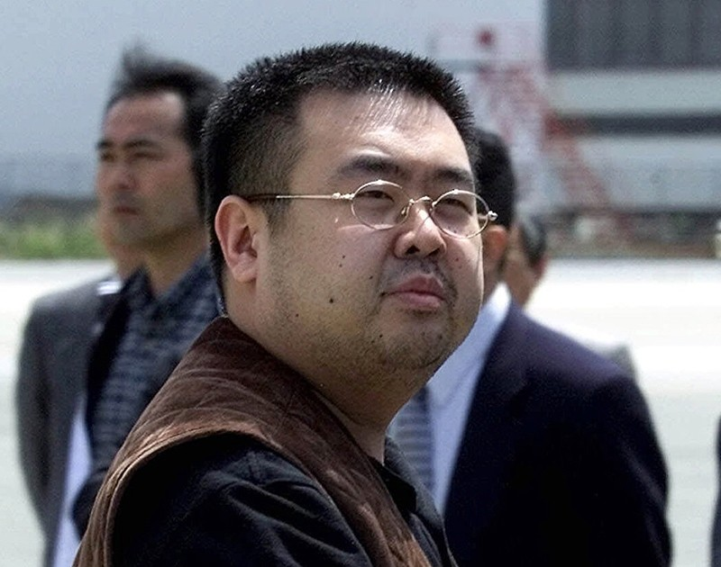 In this May 4, 2001, file photo, Kim Jong Nam, the eldest son of then North Korean leader Kim Jong Il, looks at a battery of photographers as prepares to board a plane to Beijing at an airport in Narita, northeast of Tokyo, Japan. (AP Photo)