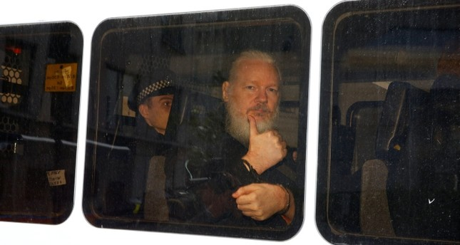 WikiLeaks founder Julian Assange is seen in a police van after was arrested by British police outside the Ecuadorian embassy in London, Britain April 11, 2019. (Reuters Photo)