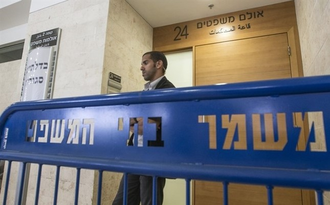 A security officer standing guard outside an Israeli court (File photo / AFP)