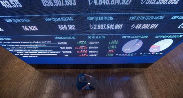 A Turkish trader walks under a display board during the morning session at the 'Borsa Istanbul' Stock Exchange in Istanbul, Turkey, 10 August 2018. (EPA Photo)