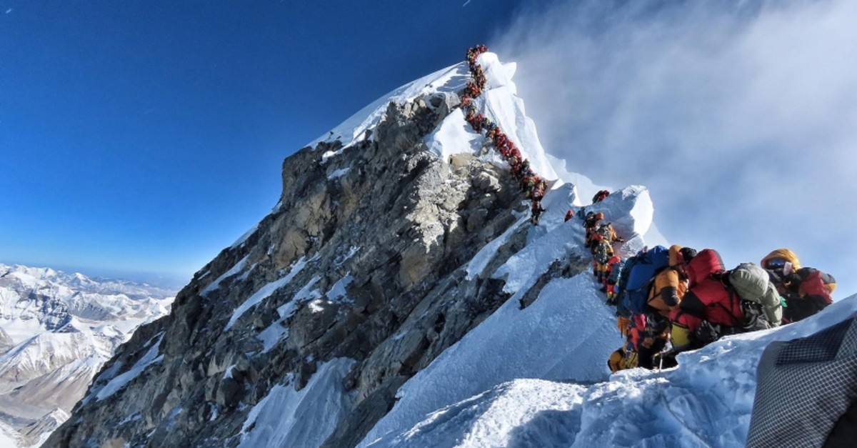In this file handout photo taken on May 22, 2019 and released by climber Nirmal Purja's Project Possible expedition shows heavy traffic of mountain climbers lining up to stand at the summit of Mount Everest. (AFP Photo)