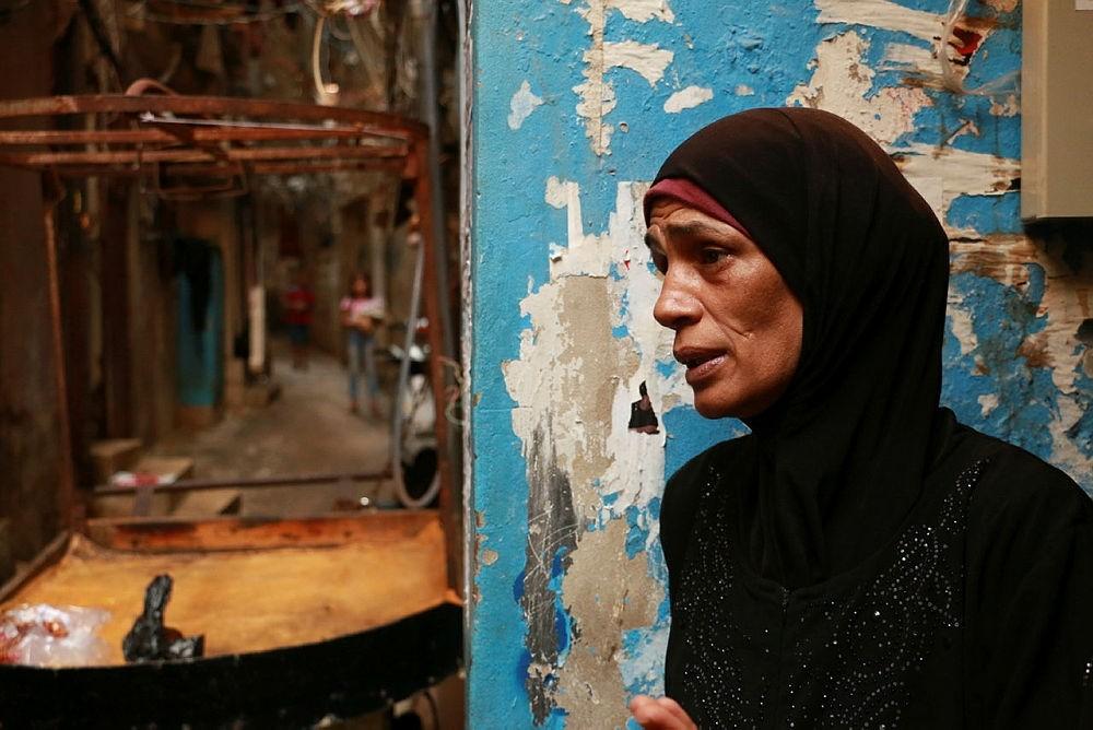 Amal al-Qirmi, 50, one of the survivors of the massacres, talks to Anadolu Agency in Lebanon on September 16, 2017.