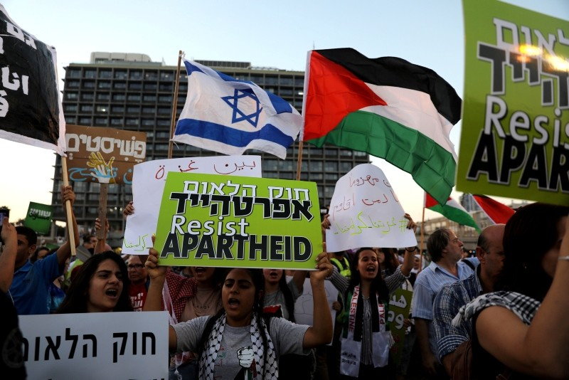 Israeli Arabs and their supporters take part in a rally to protest against Jewish nation-state law in Rabin square in Tel Aviv, Israel  August 11, 2018. (Reuters Photo)