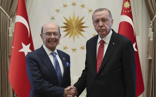 President Recep Tayyip Erdoğan R shakes hands with U.S. Commerce Secretary Wilbur Ross, Ankara, Sept. 10, 2019.
