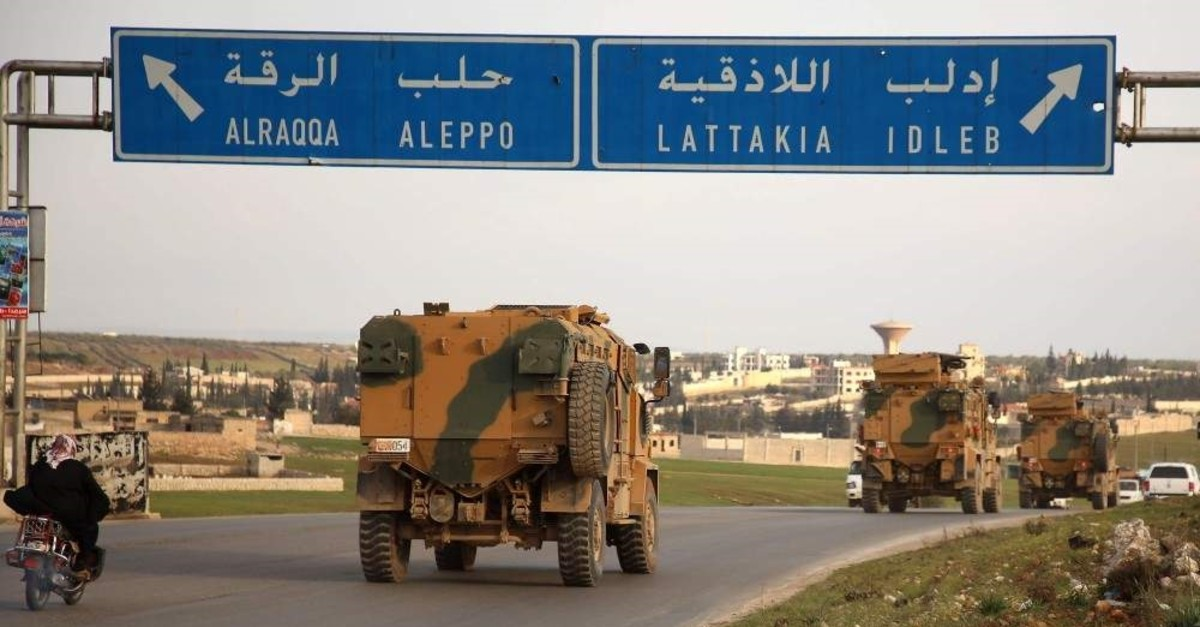 Turkish military vehicles drive in a convoy headed for the south of Idlib province as they pass by the town of Atareb in the western countryside of Aleppo on Feb. 3, 2020. (AFP Photo)