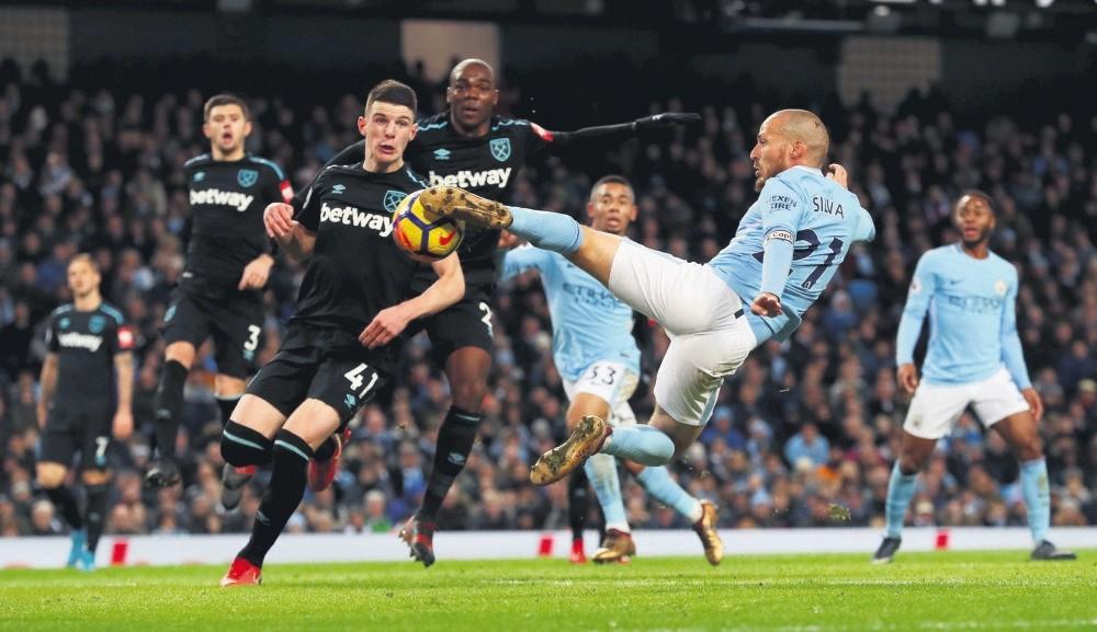Manchester City's David Silva scores second goal against West Ham United at Etihad Stadium on Dec. 3.
