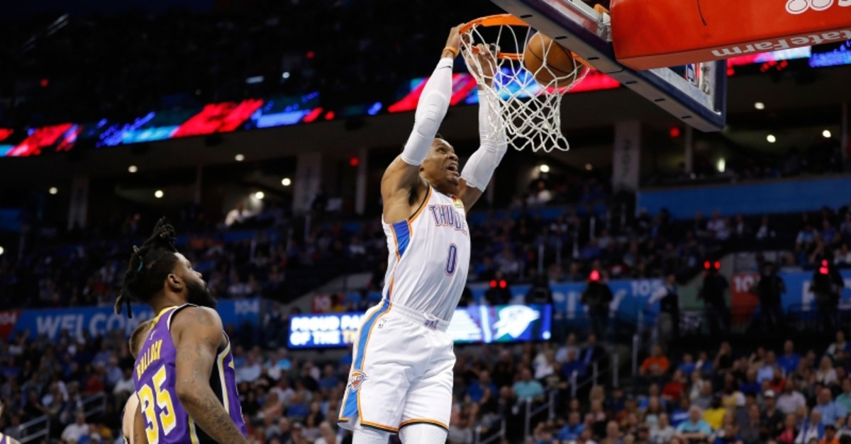 Oklahoma City Thunder guard Russell Westbrook (0) dunks the ball as Los Angeles Lakers guard Reggie Bullock (35) looks on during the second half at Chesapeake Energy Arena. (Alonzo Adams-USA TODAY Sports via Reuters)
