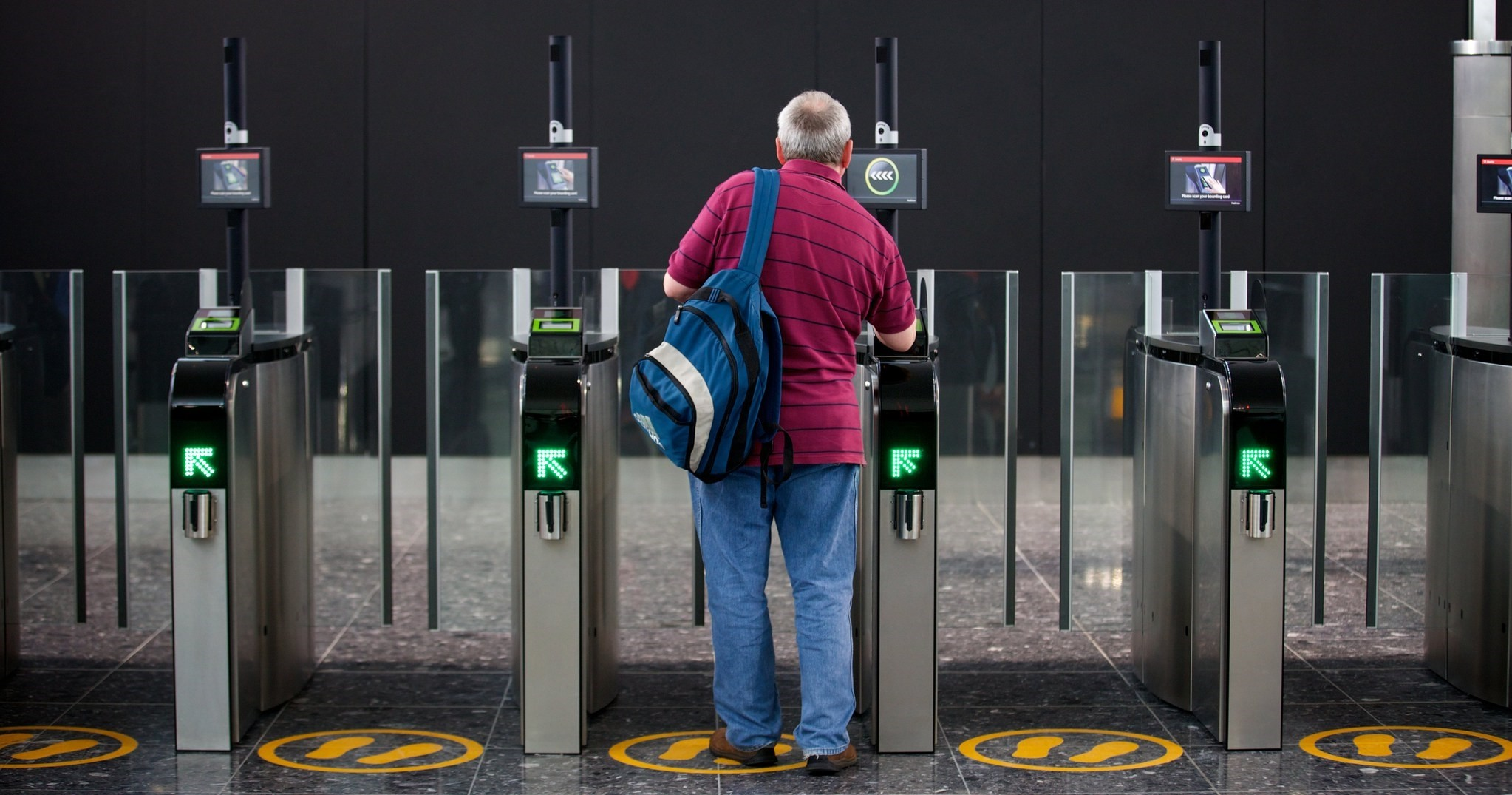 A passenger scans his boarding card in the new Terminal 2 at Heathrow Airport in London, Britain, 04 June 2014. (EPA Photo)