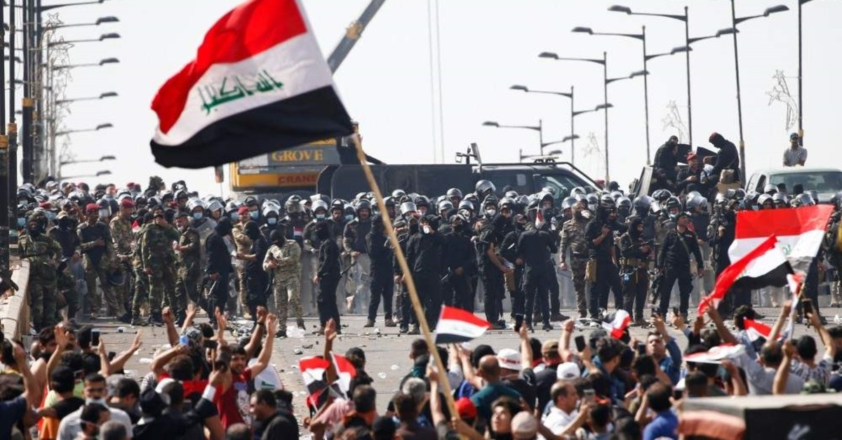 Iraqi security forces stand in front of demonstrators during a protest, Baghdad, Iraq Oct. 25, 2019. (REUTERS Photo)