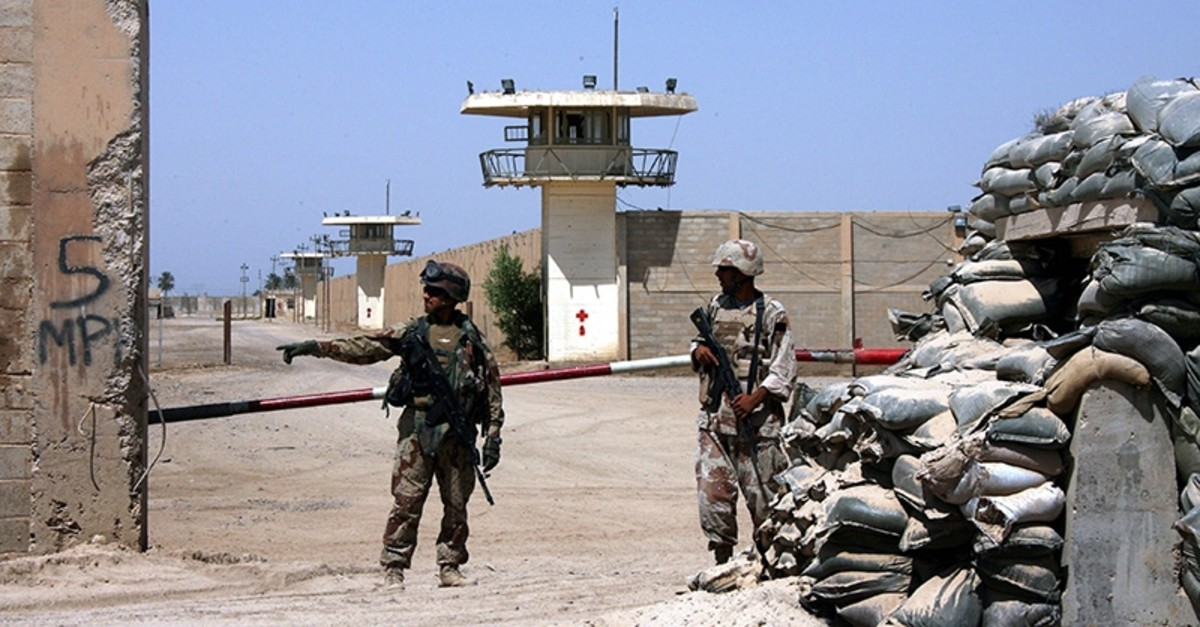 In this Sept. 2, 2006, file photo, Iraqi army soldiers stand guard at the Abu Ghraib prison, after taking over from U.S. soldiers, on the outskirts of Baghdad, Iraq. (AP Photo)