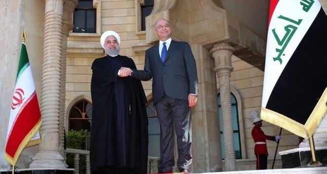 الرئيس العراقي مستقبلا روحاني (رويترز)